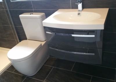 Black Luxury Bathroom with Metallic Mosaic Inlay